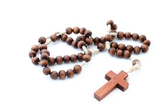 Wooden rosary on white Stock Photo