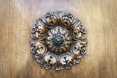 Wooden rosette on door Stock Images