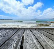 Wooden rostrum on sea view Stock Image