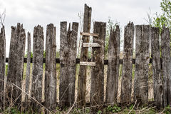 Wooden rotting old fence in the village Royalty Free Stock Images