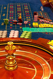 Wooden roulette wheel spinning Royalty Free Stock Photos