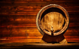 Wooden round barrel with old planks on background Stock Image