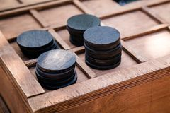 Wooden round black chips. Quest for children and adults. Wooden round black chips. Quest for children and adults royalty free stock photography