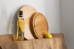 Wooden round boards. And bottle on shelf Stock Images