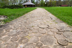 Wooden round log path closeup in recreation camping site Royalty Free Stock Photo