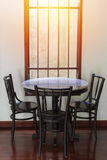 Wooden round table and chair chiness style near window have ray Stock Photos