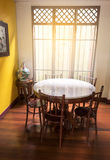 Wooden round table and chair chiness style near window have ray Royalty Free Stock Photos