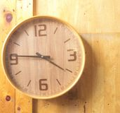 Wooden round wall watch - clock on wooden background eco nature background royalty free stock images
