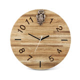 Wooden round wall watch with owl toy - clock isolated on white b Royalty Free Stock Images