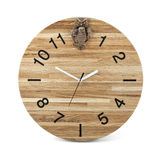 Wooden round wall watch with owl toy - clock isolated Royalty Free Stock Photos