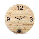 Wooden round wall watch with owl toy - clock isolated on white Royalty Free Stock Photography