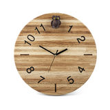 Wooden round wall watch with owl toy - clock on white Royalty Free Stock Image