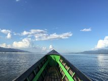 Wooden row boat on Inle. Bow of a wooden row boat on Inle Lake, Myanmar royalty free stock photography