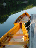 Wooden Row boats. On lake tried to dock in morning light Stock Image
