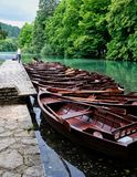 Wooden Row Boats, Plitvice National Park, Croatia. A row of wooden rental rowboats moored on Plitvice Lakes, Plitvice National Park, a UNESCO listed world Stock Photos