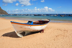 Wooden rowboat on beach Royalty Free Stock Image