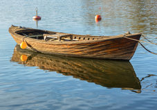 Wooden rowboat in a lake. Royalty Free Stock Photo