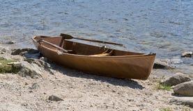 Wooden rowboat waterside Stock Image
