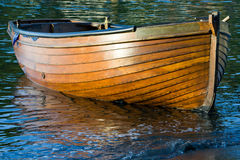 Wooden Rowing Boat. Small clinker built wooden rowing boat royalty free stock images