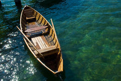 Wooden rowing boat. Details of wooden rowing boat and oars on water, seen from above Royalty Free Stock Images