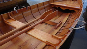 Wooden Rowing Boat. Close-up of wooden rowing boat with oars stowed Royalty Free Stock Photos
