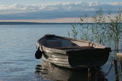 Wooden rowing boat on lake