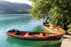 Wooden rowing boats island in Lake Bled, Slovenia Stock Photos