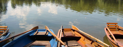 Wooden rowing boats on lake Royalty Free Stock Photo