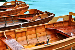 Wooden rowing boats on a wooden pier.Boats on the lake at morning Stock Photo