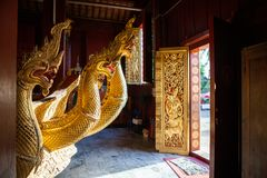 Wooden Royal cremation chariot with naga sculptures with remains of last Kings of Laos at Wat Xieng Thong temple stock photo