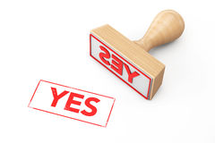 Wooden Rubber Stamp with Yes Sign Royalty Free Stock Images