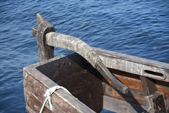 Wooden rudder near the ancient Russian ship - rooks. Controlled the boat with the help of a wooden steering wheel Royalty Free Stock Photography