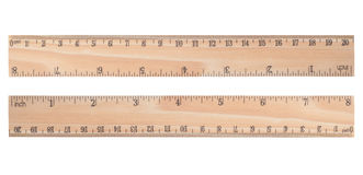 Wooden ruler. Isolated on white background stock photos