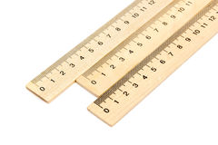 Wooden ruler on white background. Three wooden ruler with millimeter divisions located near one another on a white background Royalty Free Stock Photo