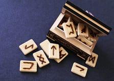Wooden runes in casket Royalty Free Stock Photo