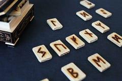 Wooden runes in casket Stock Images