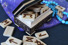 Wooden runes in casket Stock Photo