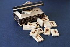 Wooden runes in casket Stock Photography