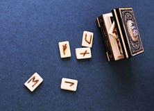Wooden runes in casket Royalty Free Stock Photos