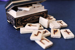 Wooden runes in casket Royalty Free Stock Images