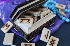 Wooden runes in casket Royalty Free Stock Image