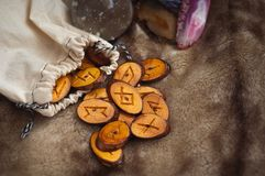 Wooden runes on the fur Royalty Free Stock Images