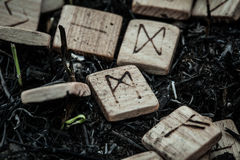 Wooden runes on the ground Stock Image