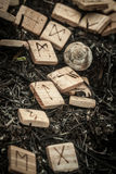 Wooden runes on the ground Royalty Free Stock Image