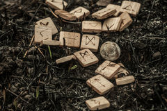 Wooden runes on the ground Stock Photo