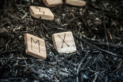 Wooden runes on the ground Royalty Free Stock Images