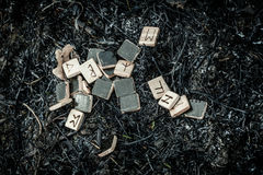 Wooden runes on the ground Stock Images