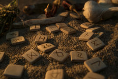 Wooden runes handmade on sackcloth. Esoteric subjects. Divination and prediction on runes, mysticism or esoteric. Magic Stock Image