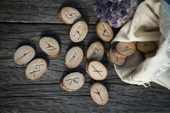 Wooden runes handmade. Wood runes handmade on an old wooden table. Esoteric subjects stock images