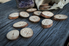 Wooden runes handmade. Wood runes handmade on an old wooden table. Esoteric subjects stock photography